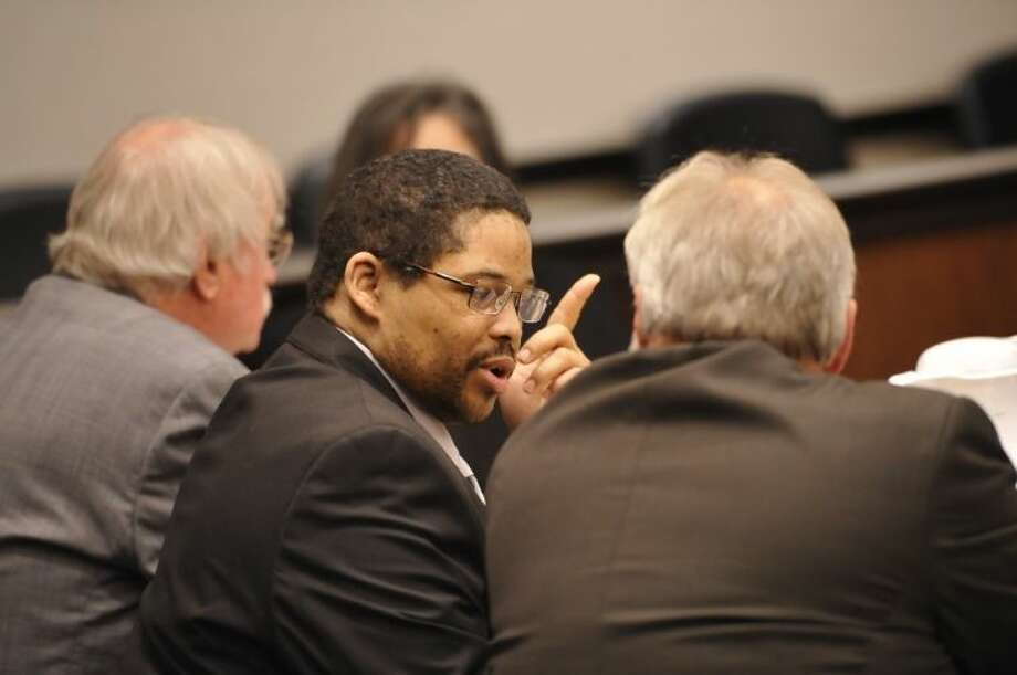 Bartholomew Granger, center, is flanked to his attorneys James Makin, right, and Sonny Cribbs April 22 before the start of his trial in Galveston. Photo: Dave Ryan