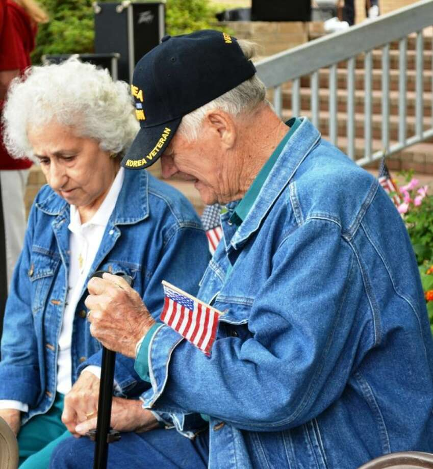 W.E. and Lena Owens pray together during National Day of Prayer Thursday on the steps of the Montgomery County Courthouse.