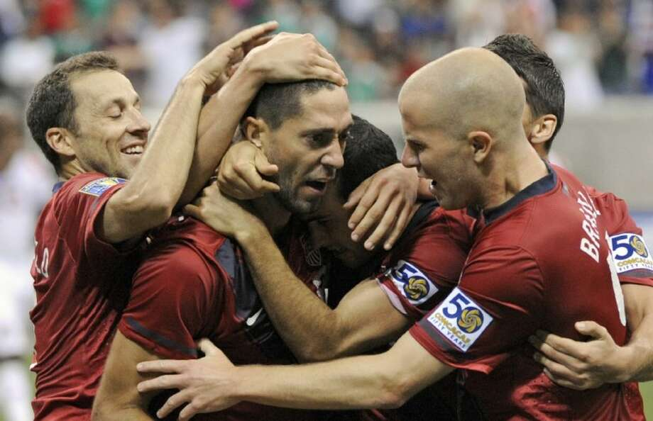 The United States' Clint Dempsey, center, is congratulated by teammates after scoring a goal against Panama during the second half of a CONCACAF Gold Cup semifinal match Wednesday at Reliant Stadium in Houston.