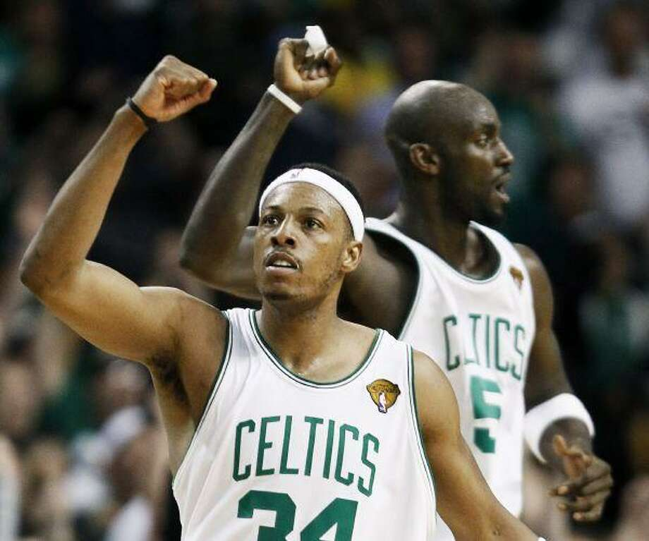 Boston Celtics forward Paul Pierce, front, and forward Kevin Garnett react during the fourth quarter in Game 5 against the Los Angeles Lakers on Sunday in Boston. / FR170221 AP