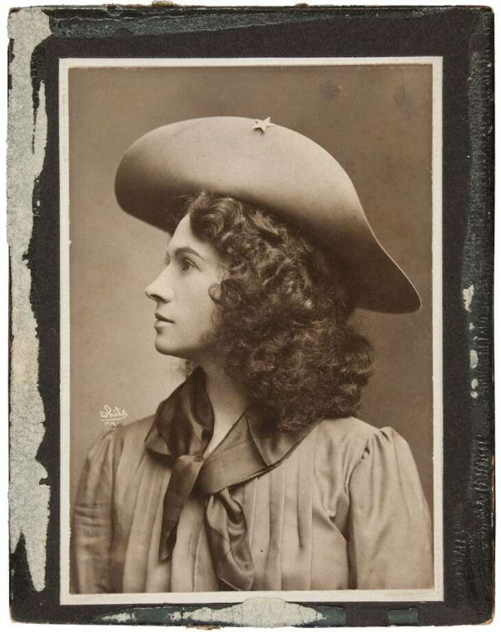 This handout photo, provided by Heritage Auctions, shows Annie Oakley in one of her cabinet photos. Oakley wears the dark wig she wore for The Western Girl was taken in New York between 1902 and 1904. Relatives of Oakley are selling items that once belonged to the legendary sharpshooter including a Stetson hat, guns, letters and photographs. Heritage Auctions will offer up about 100 items related to Oakley on Sunday in Dallas. Photo: HOEP