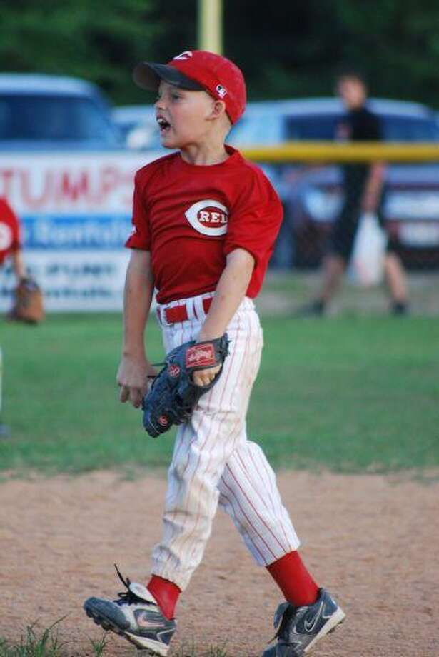 Derek Berg, second baseman for the 8U Reds, shows his intense enthusiasm to make an out in the championship game against the Angels.