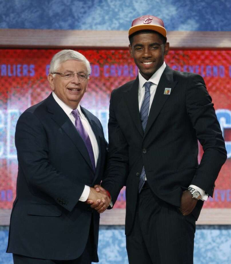 NBA Commissioner David Stern, left, poses with the No. 1 overall draft pick, Kyrie Irving, of Duke, who was selected by the Cleveland Cavaliers on Thursday in Newark, N.J. Photo: Mel Evans