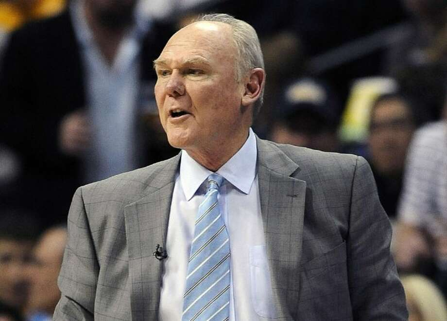Denver Nuggets coach George Karl looks on in the second quarter of Game 1 during a first-round series against the Golden State Warriors on April 20 in Denver. Photo: Chris Schneider