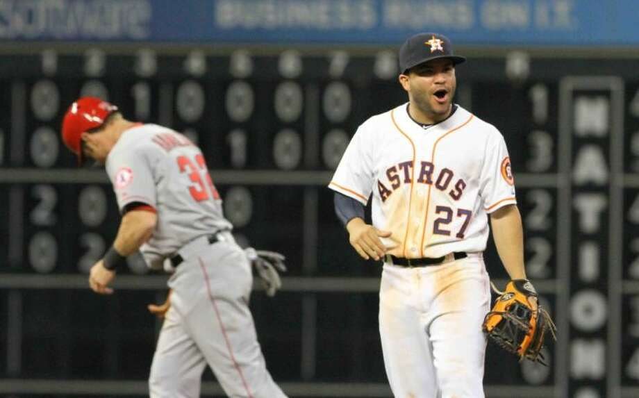 Houston Astros second baseman Jose Altuve celebrates after turning a double play to end a 3-1 win over the Los Angeles Angels of Anaheim on Wednesday at Minute Maid Park in Houston. Photo: Staff Photo By Jason Fochtman
