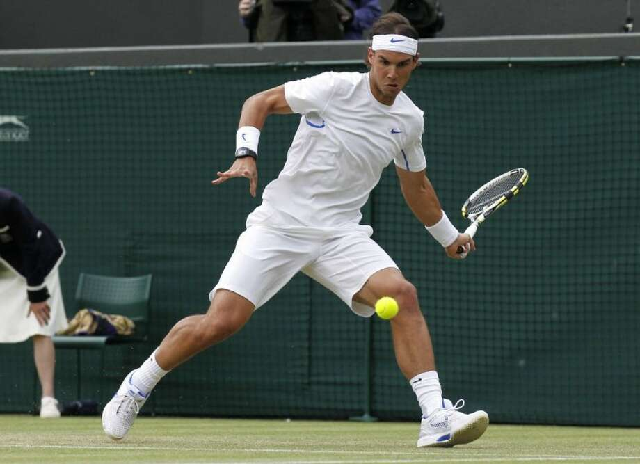 Spain's Rafael Nadal returns a forehand shot to Luxembourg's Gilles Muller during their match at the All England Lawn Tennis Championships at Wimbledon on Friday. Photo: Anja Niedringhaus