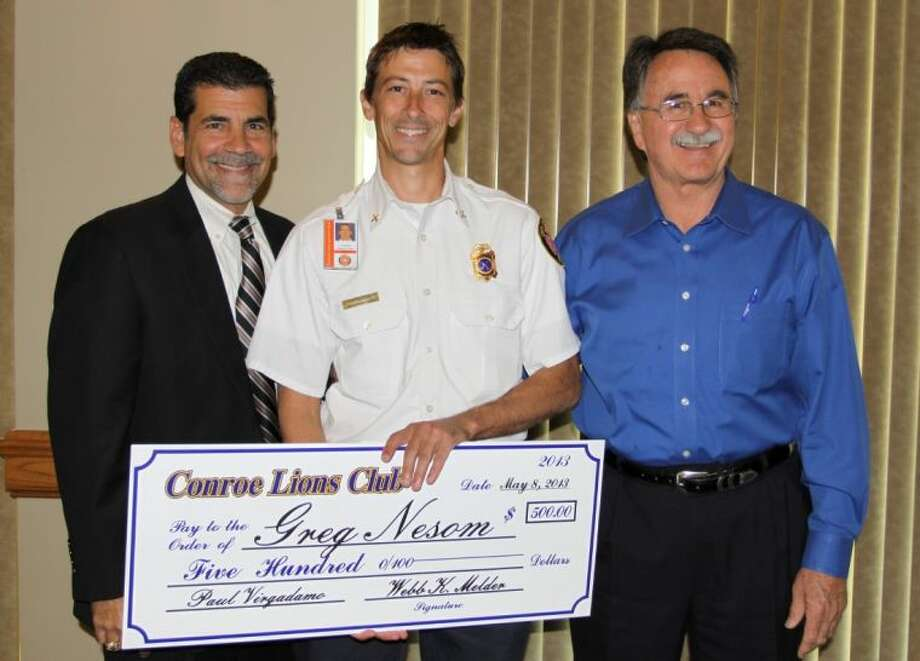 Greg Nesom, with the Conroe Fire Department, was named Employee of the Year during the Conroe Noon Lions Club lunch Wednesday. Pictured are City Administrator Paul Virgadamo, Nesom and Conroe Mayor Webb Melder.