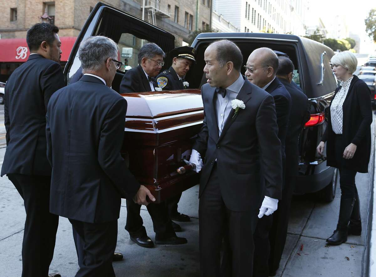 Pallbearers carry Rose Pak into Old Saint Mary's Cathedral on California Streer for the funeral service for the Chinatown community leader in San Francisco, Calif. on Saturday, Sept. 24, 2016.