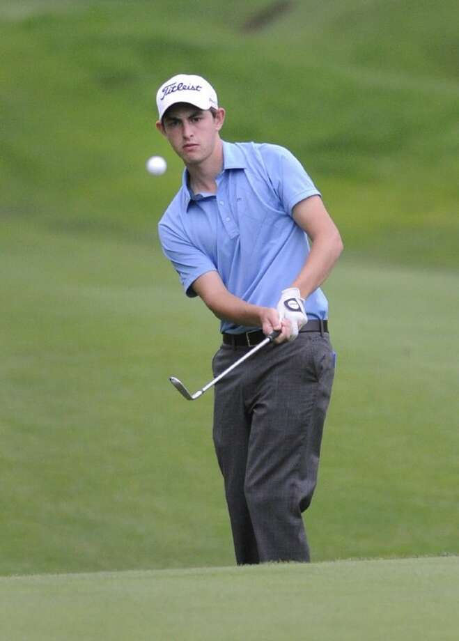 Amateur Patrick Cantlay hits his second shot on the 15th hole of his second round of the rain-delayed Travelers Championship in Cromwell, Conn., on Friday. Photo: Fred Beckham