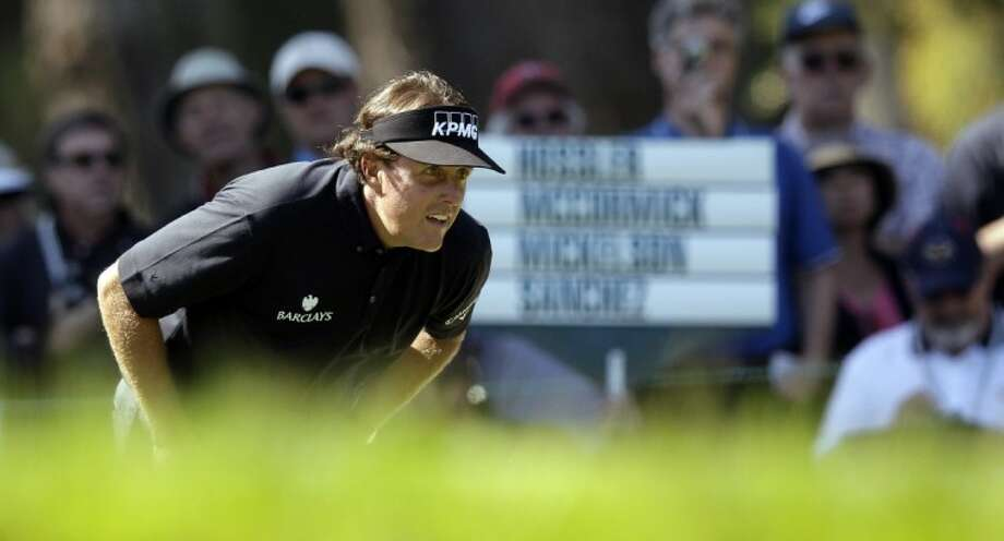 Phil Mickelson looks over a shot on the seventh hole during a practice round for the U.S. Open Championship golf tournament Tuesday at The Olympic Club in San Francisco. Photo: Charlie Riedel
