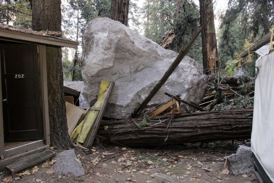 In this Oct. 20, 2008 file photo, a boulder sits atop debris after it fell in Curry Village in Yosemite National Park, Calif. Falling boulders are the single biggest force shaping Yosemite Valley, one of the most popular tourist destinations in the national park system. Now swaths of some popular haunts are closing for good after geologists confirmed that unsuspecting tourists and employees are being lodged in harm's way. Photo: Paul Sakuma