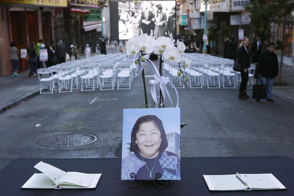 A portrait of Rose Pak and guest books are placed on a table on Grant Avenue which was closed to traffic and available for an overflow crowd to watch the funeral service for Chinatown community leader Rose Pak at Old Saint Mary's Cathedral in San Francisco, Calif. on Saturday, Sept. 24, 2016.