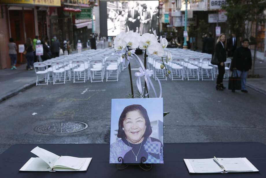 A portrait of Rose Pak and guest books are placed on a table on Grant Avenue which was closed to traffic and available for an overflow crowd to watch the funeral service for Chinatown community leader Rose Pak at Old Saint Mary's Cathedral in San Francisco, Calif. on Saturday, Sept. 24, 2016. Photo: Paul Chinn, The Chronicle