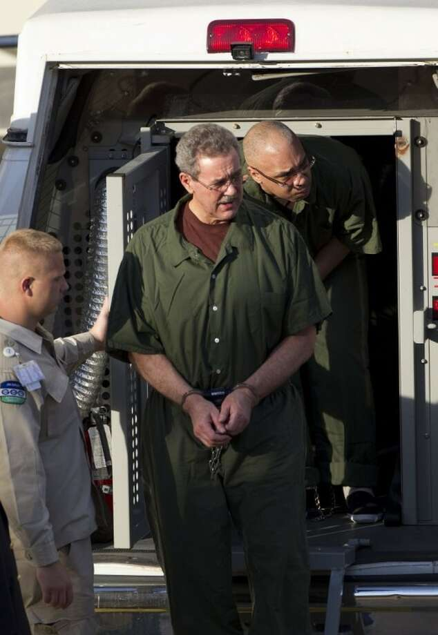 R. Allen Stanford enters the Bob Casey Federal Courthouse in Houston Thursday, where he was sentenced to 110 years in prison for bilking investors out of more than $7 billion over 20 years in one of the largest Ponzi schemes in U.S. history. Photo: Johnny Hanson