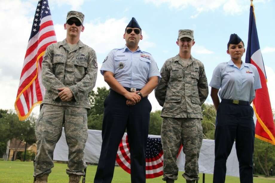From left to right, Staff Sgt. Dustin Burgess, Staff Sgt. Christian Chavez, Airman 1st Class Stephen Warren, and Airman Alyssa Guerra attended Thursday's ribbon cutting for Homes for Heroes. They welcomed the community support for military personnel.