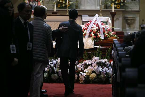 Mourners pay their respects to Rose Pak during the funeral service for the Chinatown community leader at Old Saint Mary's Cathedral in San Francisco, Calif. on Saturday, Sept. 24, 2016.
