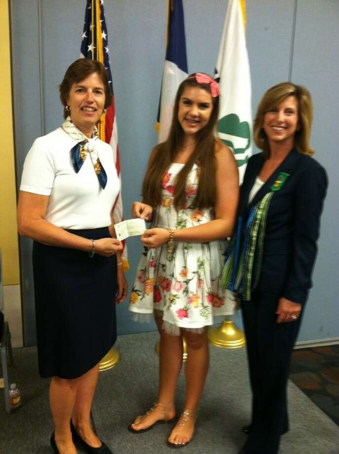 From left to right: Stacy Methvin, president and chair of the board of Girl Scouts of San Jacinto Council, Demme Durrett and Mary Vitek, CEO of Girl Scouts of San Jacinto Council. Durrett, a local Girl Scout who is a student at The John Cooper School, received the Gold Award by the Girl Scouts of San Jacinto Council May 20 for her organization of the 2011 Human Rights Walk and Festival in The Woodlands.