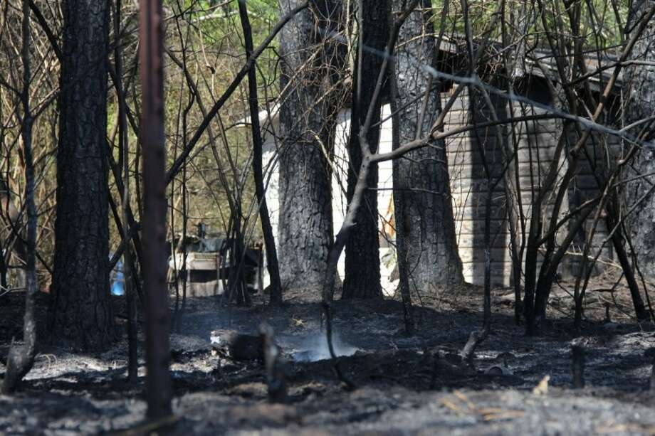 Fire crews from Needham, South Montgomery County and River Plantation raced to extinguish a blaze that threatened at least two homes off Sleepy Hollow Road Saturday afternoon. The fire claimed two acres of land.