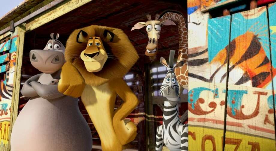 """This film image released by DreamWorks Animation shows, Gloria the Hippo, voiced by Jada Pinkett Smith, from left, Alex the Lion, voiced by Ben Stiller, Melman the Giraffe, voiced by David Schwimmer, and Marty the Zebra, voiced by Chris Rock in a scene from """"Madagascar 3: Europe's Most Wanted."""" Photo: DreamWorks Animation"""