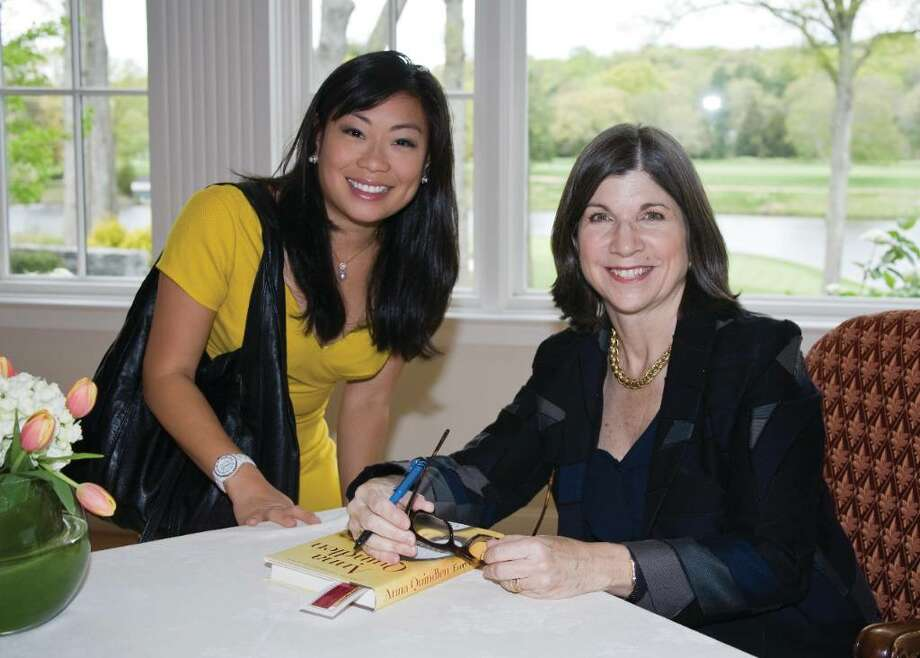Anna Quindlen signs a copy of her new novel Every Last One for Darien resident Winnie Norman at the Family Centers' Center for Hope fundraiser last Wednesday at the Wee Burn Country Club in Darien. Photo: Brittany Lyte / New Canaan News
