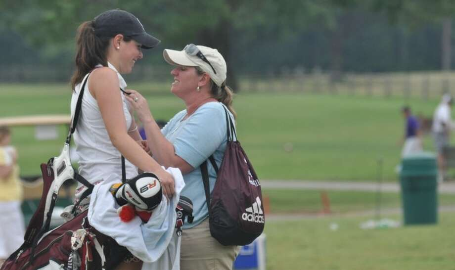 Magnolia's Kendall Anderson is met by her mother after finishing her round at the UIL State Golf Championships at Jimmy Clay Golf Course in Austin last month. Photo: Keith MacPherson