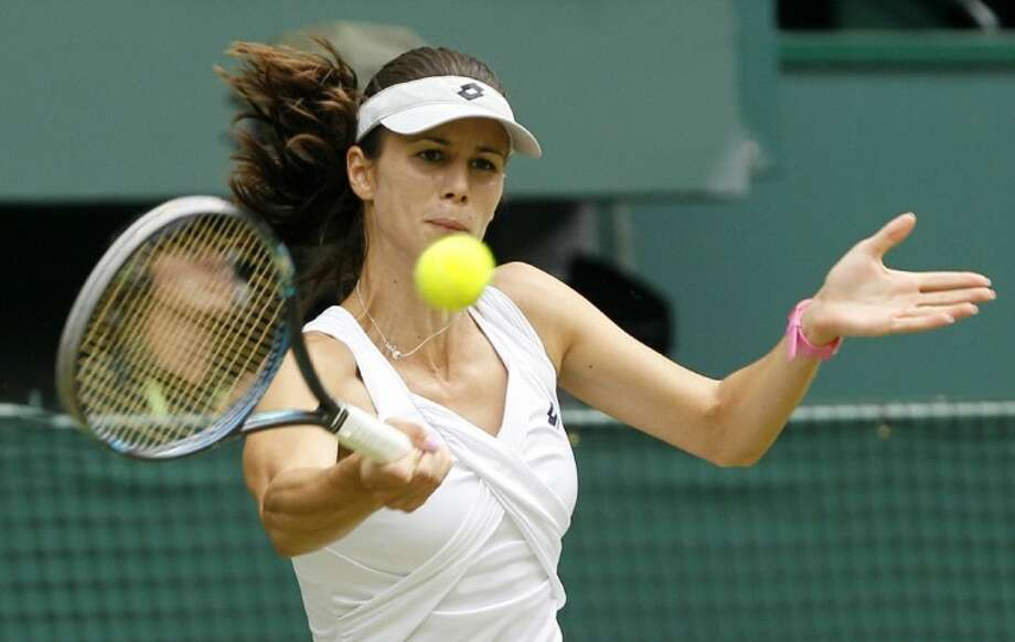 Bulgaria's Tsvetana Pironkova returns a forehand shot to Venus Williams during their match at the All England Lawn Tennis Championships at Wimbledon on Monday.