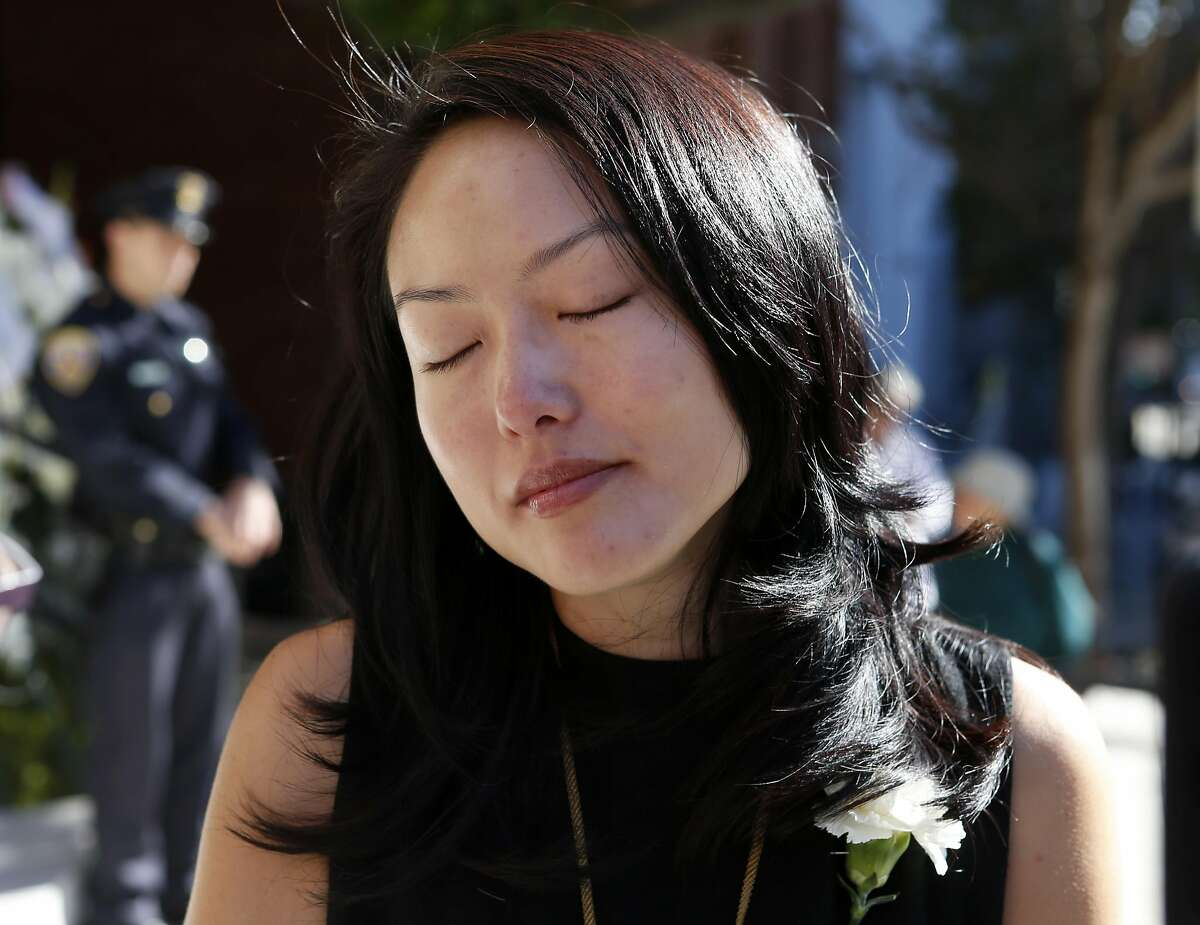 Supervisor Jane Kim pauses to collect her thoughts before the funeral service for Chinatown community leader Rose Pak at Old Saint Mary's Cathedral in San Francisco, Calif. on Saturday, Sept. 24, 2016.