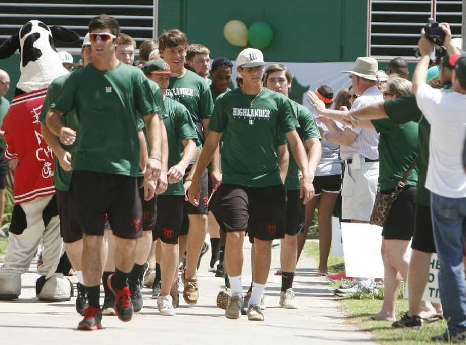 The Woodlands players make their way to the team bus during a send-off on Thursday at Scotland Yard. Photo: Staff Photo By Eric Swist