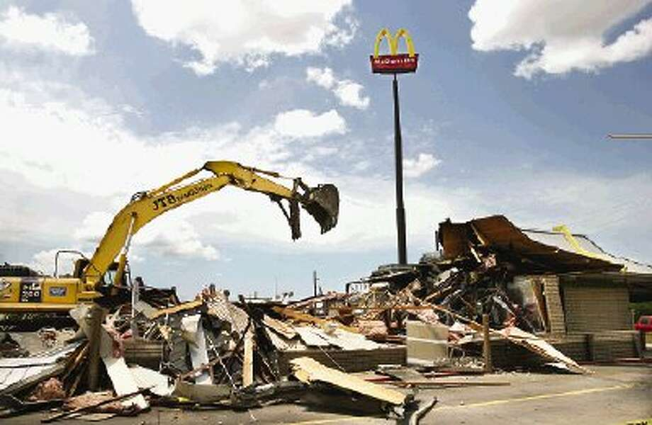 Heavy equipment knocks down the McDonald's at 909 W. Davis to make way for a new, updated restaurant, according to company officials.