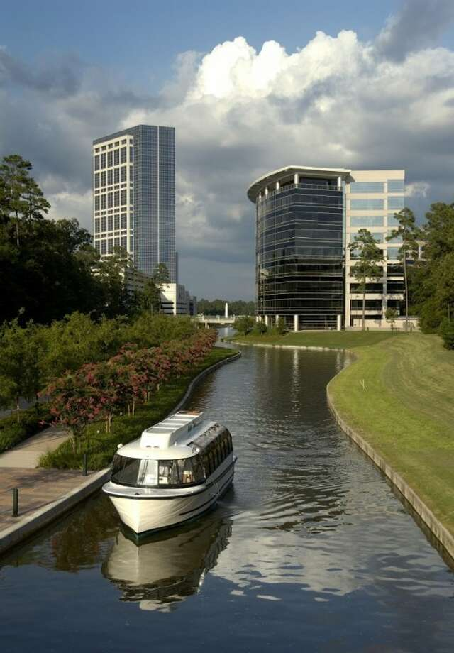 The Woodlands Waterway is shown, with the Anadarko Tower in the background at left. The Howard Hughes Corporation announced Wednesday it is acquiring The Woodlands Development Corporation as a wholly owned subsidiary.