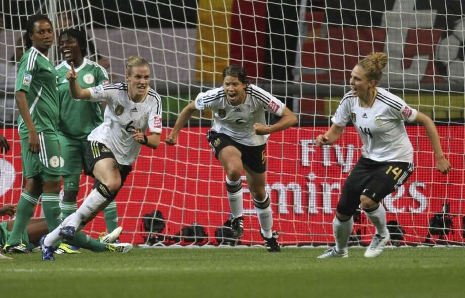 Germany's Simone Laudehr, front left, celebrates after scoring during a Group A match against Nigeria at the Women's World Cup in Frankfurt, Germany, on Thursday. Photo: Michael Probst