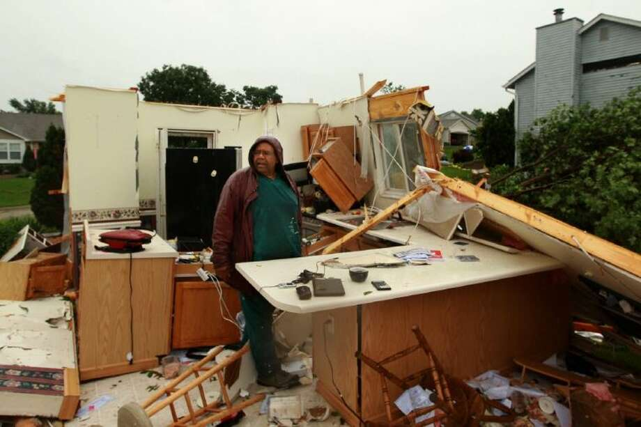 Wilburn Shaw looks for personal items in the remains of his kitchen in his home on Saturday after Friday night's storm that passed through St. Charles, Mo., area. Photo: Huy Mach