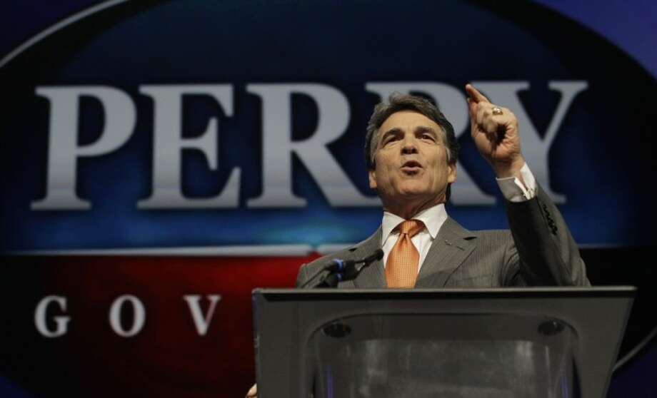 "In this June 7 photo Texas Gov. Rick Perry speaks during the Texas Republican Convention in Fort Worth, Texas. For Perry, saying ""no"" to the federal health care law could also mean turning away coverage for up to 1.3 million people. Photo: LM Otero"
