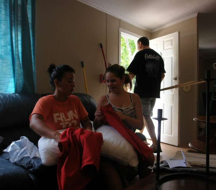 Sandra Burton, left, and Kaila Souheaver lend a helping hand putting pillows together Sunday afternoon during Project: Love One's effort to remodel the Bethel Ranch foster care facility in Montgomery.