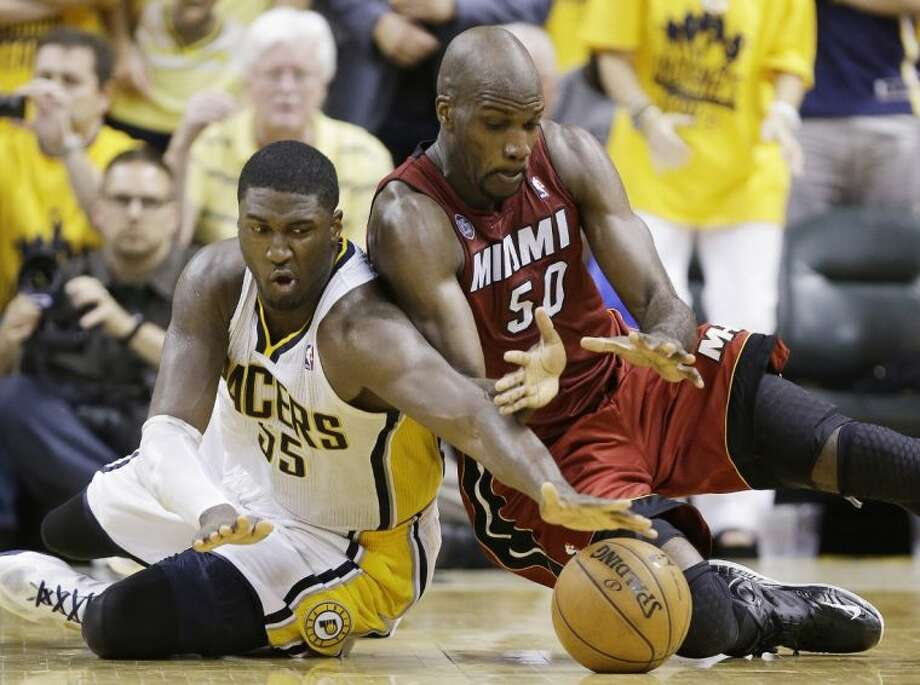 The Pacers' Roy Hibbert, left, and the Heat's Joel Anthony battle for a loose ball in Game 6. The Heat play host to the Pacers in Game 7 tonight. Photo: Michael Conroy