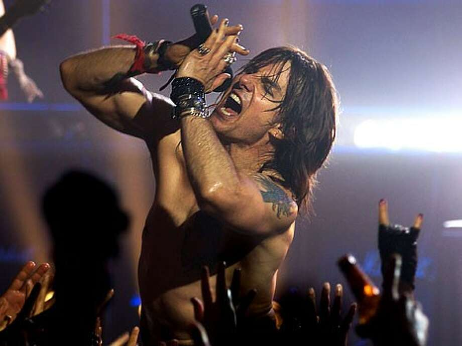 """Tom Cruise steals the show as hedonistic rock star Stacee Jaxx in the movie version of """"Rock of Ages."""""""