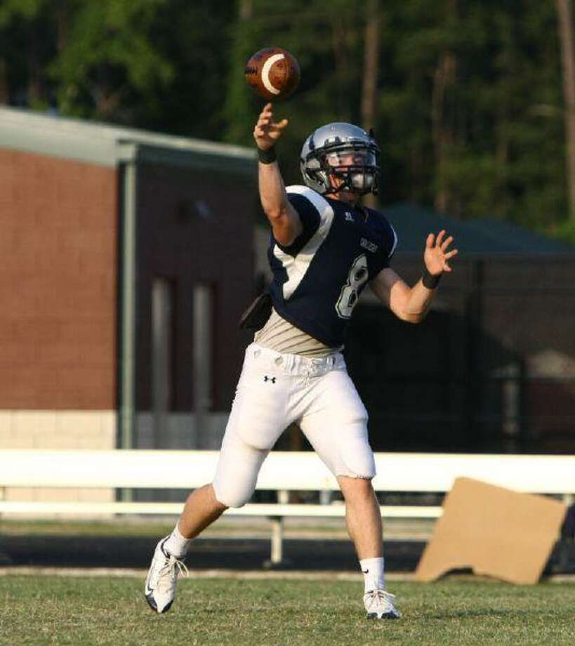 College Park Blue quarterback Tyler Chaumet delivers a pass against the Silver during Thursday's spring game.