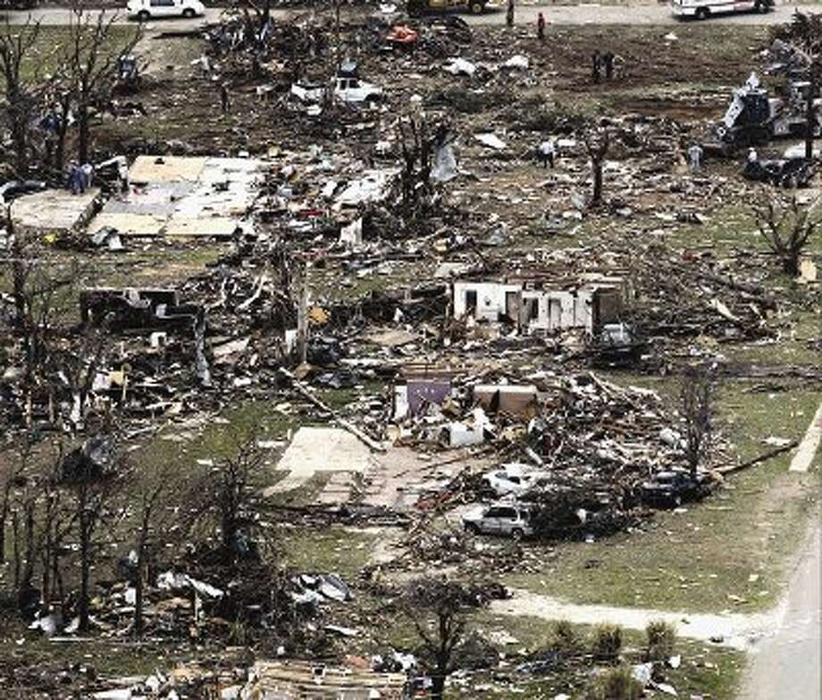 Homes are heavily damaged in this aerial view of Granbury on Thursday after multiple tornados hit the area Wednesday night. Ten tornadoes touched down in several small communities in North Texas overnight, leaving at least six people dead, dozens injured and hundreds homeless. Emergency responders were still searching for missing people Thursday afternoon. / FORT WORTH2013