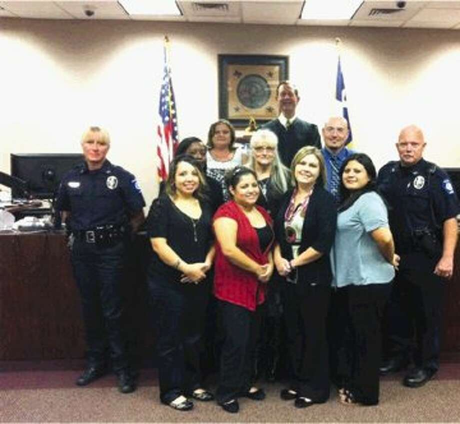 Shown here, Conroe's Municipal Court received awards recently for its traffic safety program and the implementation and enhancement of a paperless operations system that is being used by other cities across the nation.