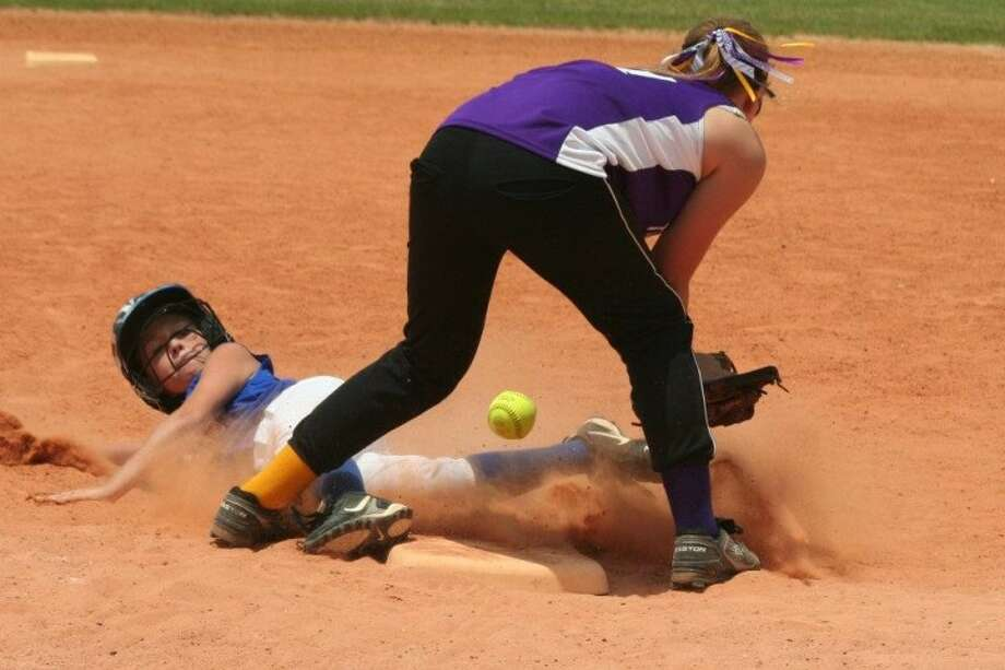Conroe Crush's Kamryn Hensley slides in safely during a game this season. The Crush won the ASA 10U State Championship over the weekend and finished the season undefeated.
