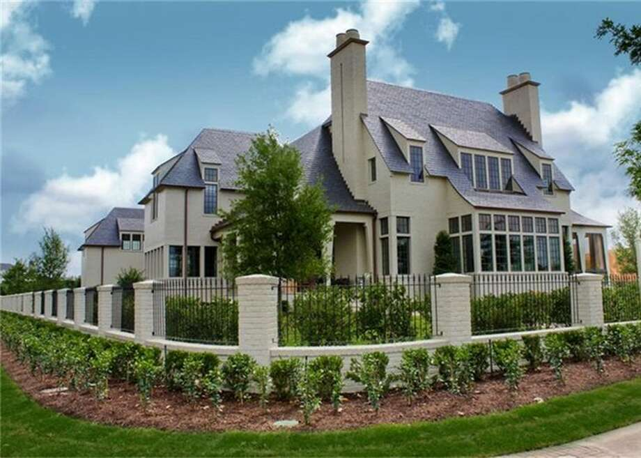 """34 East Shore Drive in East Shore, the """"Garden District"""" of The Woodlands Town Center, overlooking Lake Woodlands, is part of today's home tour in The Woodlands."""