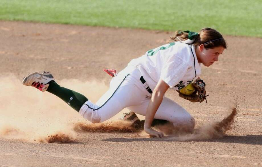The Woodlands second baseman Alyssa Jorgensen regains her balance after fielding a ground ball to complete a play at first during a Region II-5A semifinal high school softball playoff game in Georgetown on Friday. The Woodlands defeated McKinney Boyd 2-0 in Game 2 to force a Game 3. Go to HCNPics.com to view and purchase this photo, and others like it. Photo: Staff Photo By Jason Fochtman