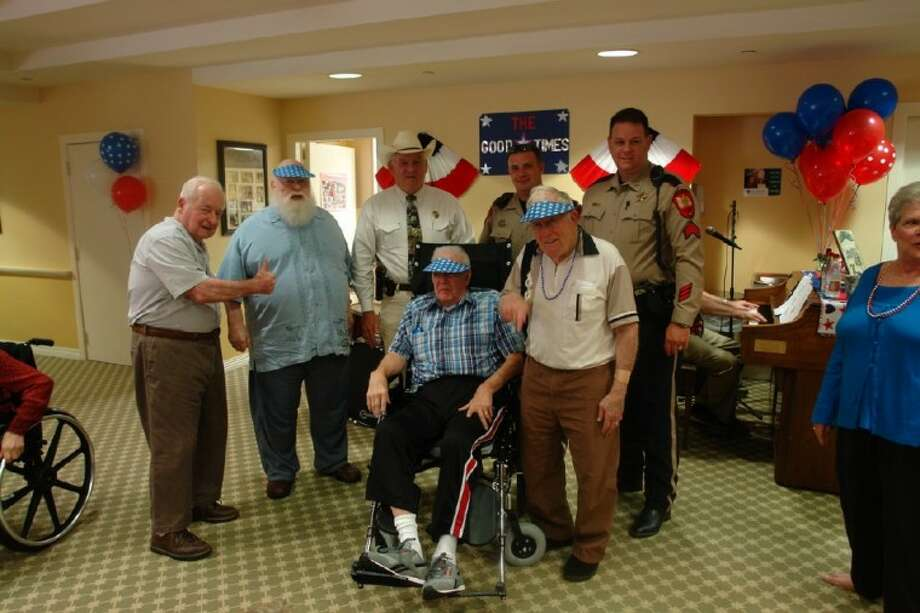 "Sheriff Tommy Gage, Deputy Brad Curtis and Sgt. Paul Cassidy of the Montgomery County Sheriff's Office, celebrated with fellow veterans at Silverado Senior Living on Bay Branch Drive in The Woodlands as part of their annual ""Born in the USA"" July 4 celebration Thursday evening. The event featured live music, food, trivia and even the opportunity for residents to dunk a fellow Silverado administrator."
