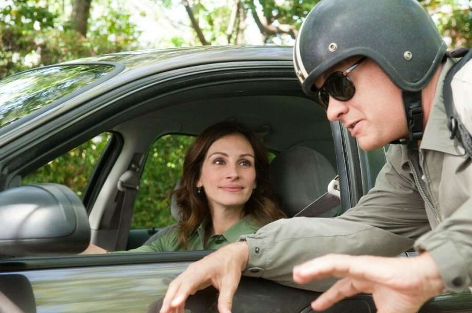 "In this film publicity image released by Universal Pictures, Julia Roberts, left, and Tom Hanks are shown in a scene from ""Larry Crowne."" Photo: Bruce Talamon"