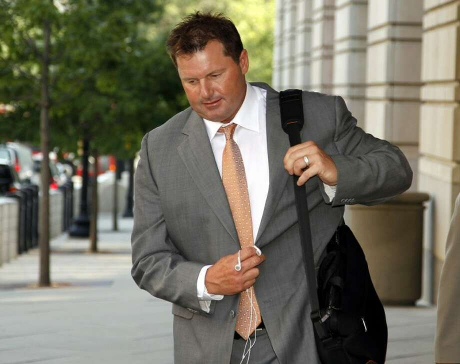 Former Major League Baseball pitcher Roger Clemens leaves federal court Thursday in Washington, where jury selection continued in his trial on charges of lying to Congress in 2008 when he denied ever using performance-enhancing drugs. Photo: Alex Brandon