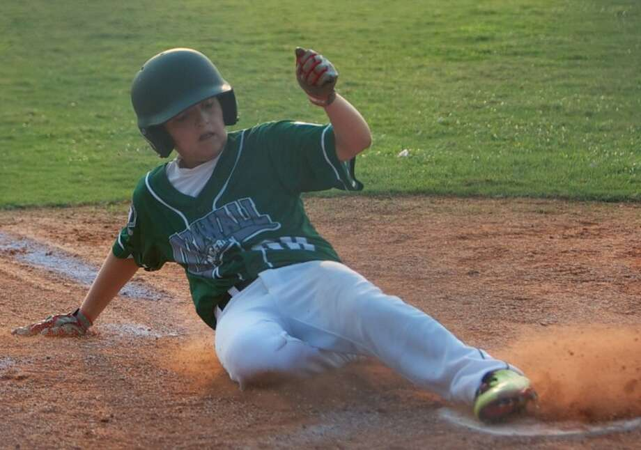 During Thursday night's game against Montgomery, ORWALL American's Brye Mourino slides into home plate. Photo: Staff Photo By Eric Swist