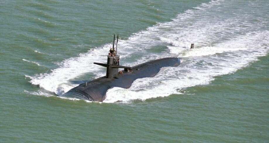 In this Feb. 1, 1999 file photo, the USS Dallas attack submarine heads into Corpus Christi. A major maritime museum is in the works in Dallas - more than 250 miles from the nearest body of salt water. The $80 million Dallas Maritime Museum will be near the Trinity River, with a proposed plan to acquire and display the 362-foot nuclear-powered attack submarine USS Dallas next to a 30,000-square-foot museum building. Photo: DAVID PELLERIN