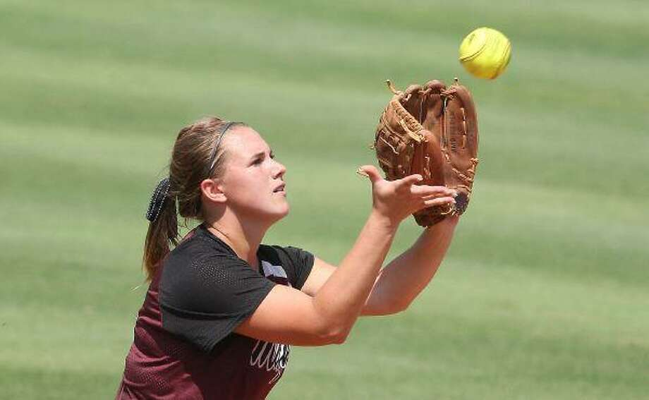 Magnolia Bulldogs Kassi Mushinski (4) gets the third out in the bottom of the seventh to bring the game into extra innings during the UIL state softball semi-final game at McCombs Field at the University of Texas in Austin on Friday afternoon. / Patric Schneider