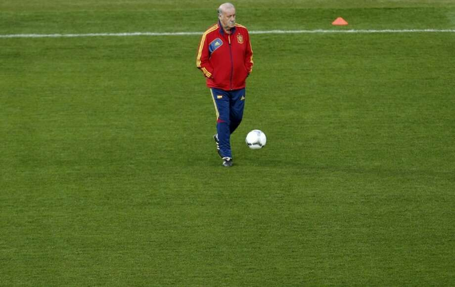 Spain coach Vicente del Bosque stands with a ball during a training session Saturday ahead of Sunday's European Championship final against Italy in Kiev, Ukraine. Photo: Jon Super