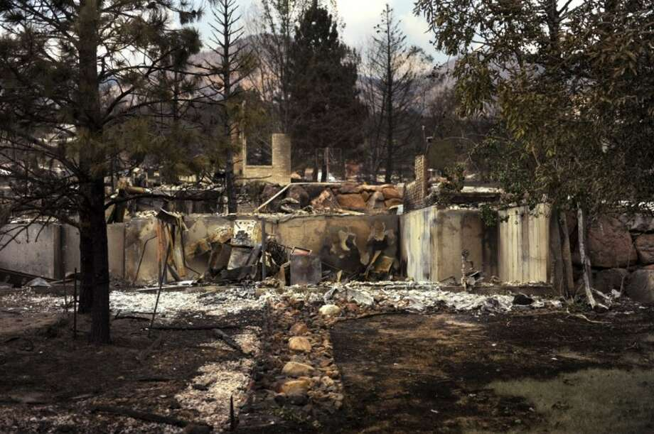 The Mountain Shadows neighborhood is left damaged by the Waldo Canyon Fire in Colorado Springs, Colo., Friday. Photo: Joe Amon